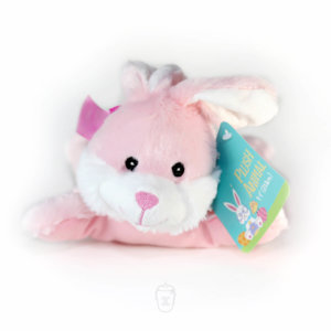 A stuffed Easter bunny that is pink and white