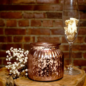 Metallic Pink Jar Candle with Brick Background